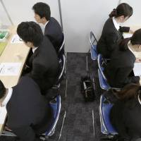 Japan's big firms kick off job interviews with 2018 recruits