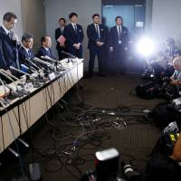 Takata Corp. Chairman and CEO Shigehisa Takada (left) attends a news conference in Tokyo on Monday. | REUTERS