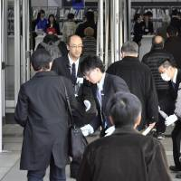 Toshiba shareholders walk to the venue of the firm's emergency meeting in March in the city of Chiba. KYODO