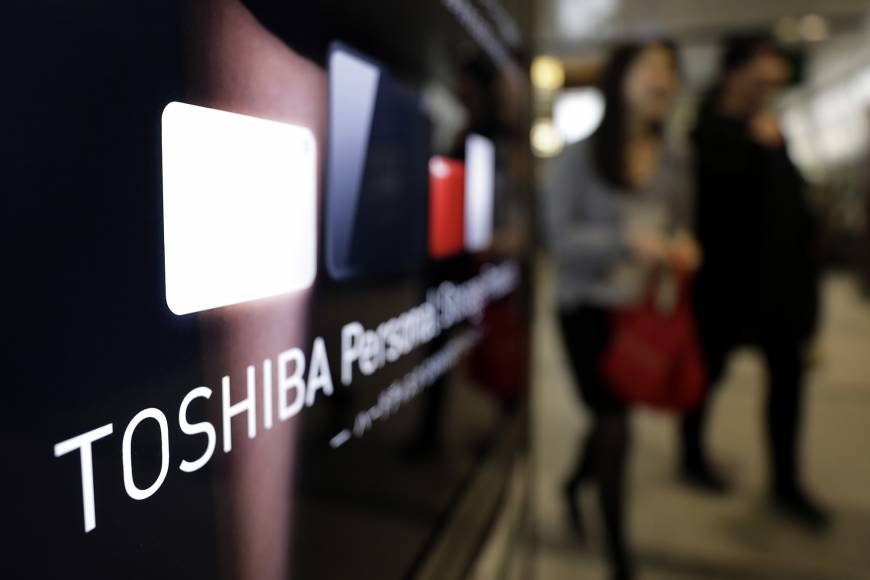 Toshiba Corp. is set to negotiate exclusively with a consortium formed by Japanese, U.S. and South Korean entities over the sale of its chip unit. | BLOOMBERG
