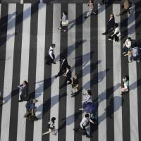 Japan's job availability improved to its strongest level in more than 40 years. | BLOOMBERG