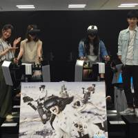 Models pose during a photo session to introduce new VR games at the headquarters of Bandai Namco Entertainment Inc. on Tuesday. | KAZUAKI NAGATA
