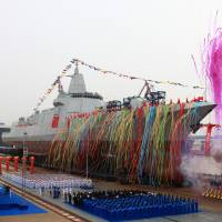 China's new type of domestically built destroyer, a 10,000-ton warship, is seen during its launching ceremony at the Jiangnan Shipyard in Shanghai on Wednesday. | REUTERS