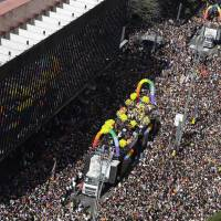 Thousands of participants march during the annual Gay Pride Parade in Sao Paulo Sunday.   AP