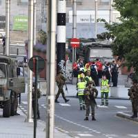 Man shouting 'Allahu Akbar' shot dead after he sets off small explosive at Brussels station in terror attack