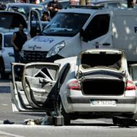 Man plows car loaded with explosives into police van on Champs-Elysees