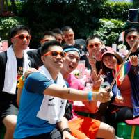 Chinese gays hear wedding bells as Taiwan move fuels hope