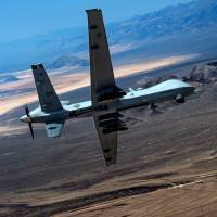 An MQ-9 Reaper remotely piloted drone performs aerial maneuvers over Creech Air Force Base, Nevada, in June 2015. | REUTERS