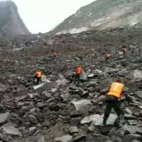 At least 140 people feared buried in massive Chinese landslide