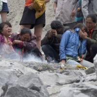 China landslide rescuers ordered to evacuate as frustration among victims' families grows
