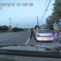 Dashcam video shows traffic stop escalating, Minnesota officer firing seven rounds into Castile's car