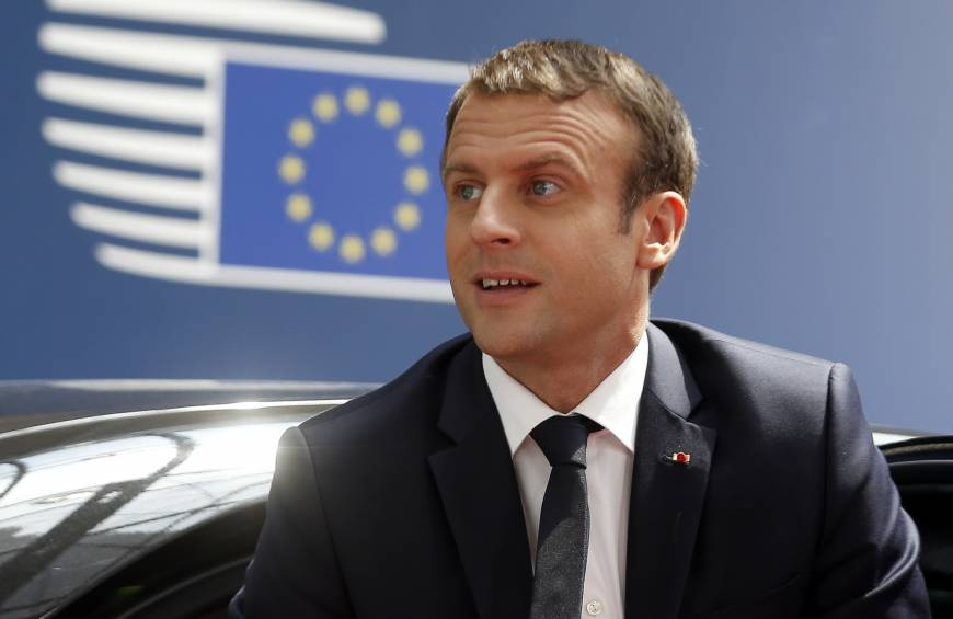 French President Emmanuel Macron, who threw his weight behind a common European defense during his election campaign, arrives Thursday for an EU summit in Brussels. | AP