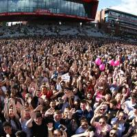 This Sunday handout photo provided by Dave Hogan for One Love Manchester shows members of the crowd at the One Love Manchester tribute concert in Manchester, northwestern England. One Love Manchester is raising money for those affected by the bombing at the end of Ariana Grande's concert in Manchester on May 22. | DAVE HOGAN / VIA AP