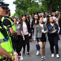 Police secure the area as fans begin to arrive at the Old Trafford Cricket Ground ahead of the One Love Manchester tribute concert in Manchester on Sunday. Nearly two weeks after a deadly suicide bombing at her concert in Manchester, U.S. star Ariana Grande is pressing ahead with a charity gig despite a terror attack on the streets of London the previous night. | AFP-JIJI