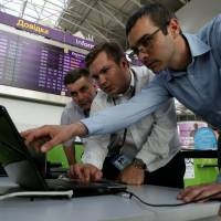 Technicians at Boryspil International Airport in Kiev work on a flight timetable for the airport's site Tuesday. | REUTERS