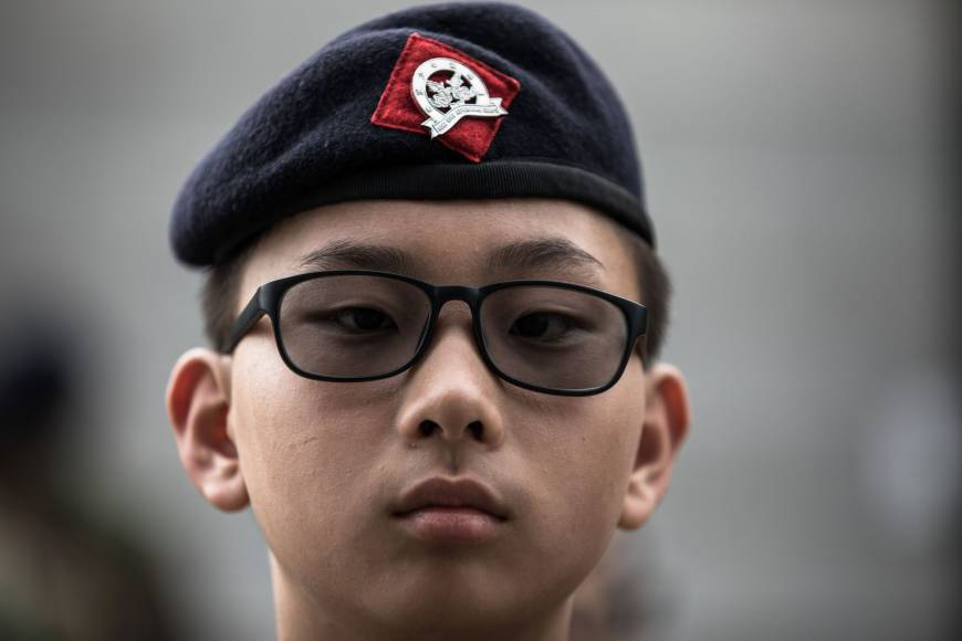 A cadet from the Hong Kong Adventure Corps takes part in a drill at their training ground in Hong Kong on May 27. | AFP-JIJI