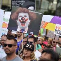 Thousands partake in LGBT rights marches across U.S. to fete gains