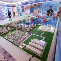 Visitors look at a model of Linglong One (ACP1000), a nuclear reactor developed by the China National Nuclear Corp., at an expo in Beijing at the end of April. | REUTERS