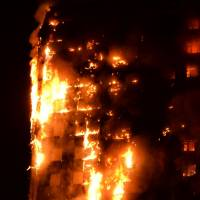 At least six dead in London high-rise blaze that saw desperate residents toss children out windows