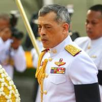 Thailand's King Maha Vajiralongkorn is seen at the monument of King Rama I after signing a new constitution in Bangkok on April 6.   REUTERS / ATHIT PERAWONGMETHA