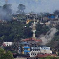 Clashes preventing retrieval of at least 100 corpses in Marawi, Philippine official says