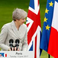 Lady Brexit meets Monsieur Europe: May, Macron hold talks