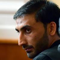 The accused head of an international smuggler group, Afghan Samsoor L., is pictured in a court room in Kecskemet, some 80 km from Hungarian capital Budapest, on Wednesday during a trial in connection with deaths of 71 migrants found in an abandoned truck in Austria in 2015. | AFP-JIJI