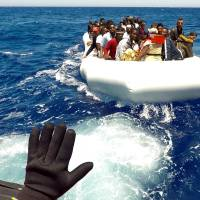 Migrants are rescued by Save the Children NGO crew from the ship Vos Hestia in the Mediterranean sea off Libya Thursday.   REUTERS