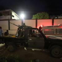 At least 17 dead as gunmen clad as troops hold hostages in Mogadishu eatery after car bomb blast
