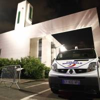 Barriers keep man from driving into crowd in front of French mosque