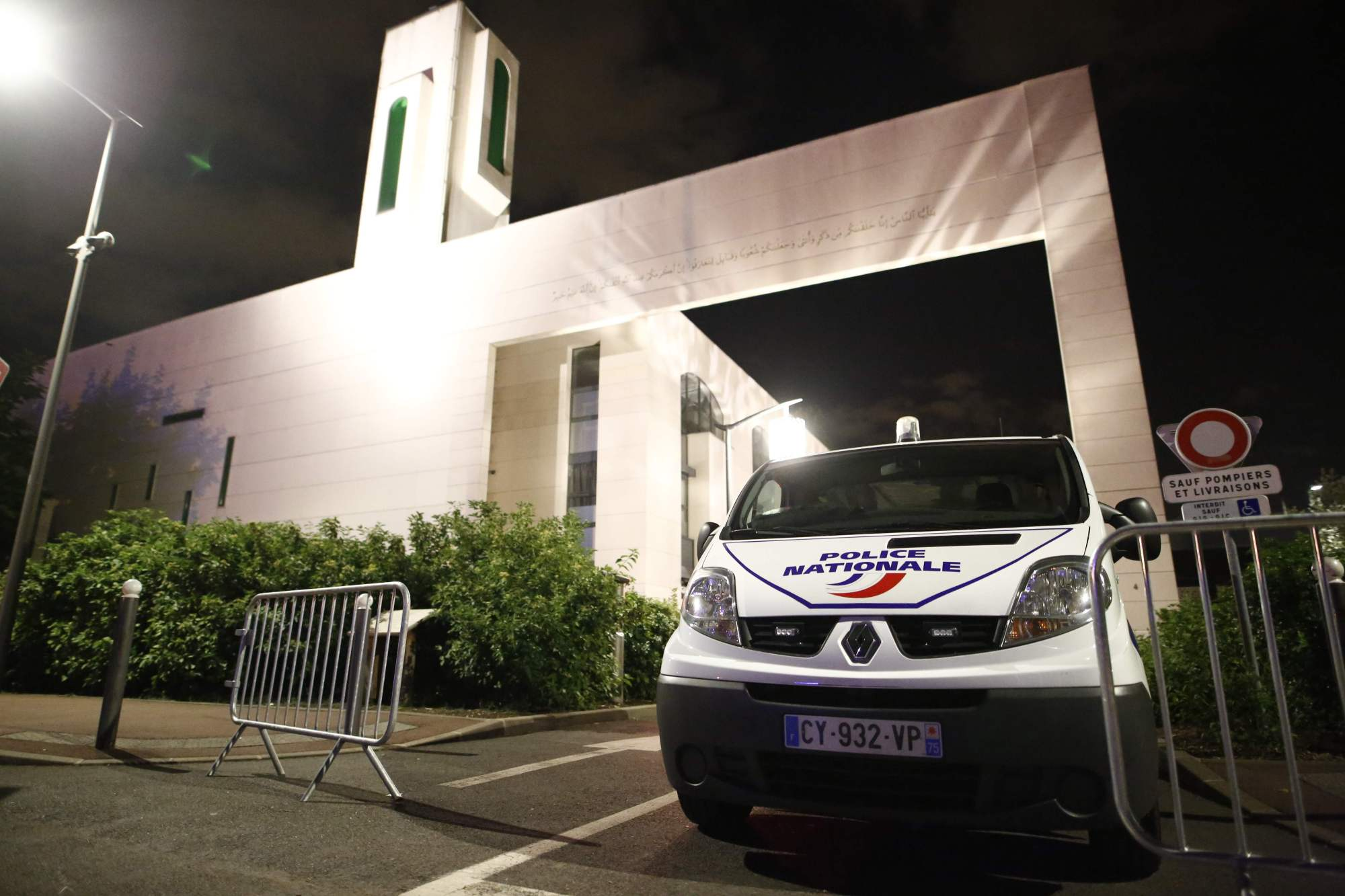 A police vehicle is stationed outside a mosque Thursday in the Paris suburb of Creteil after a man tried to drive a car into a crowd front of the Islamic religious facility.   AFP-JIJI