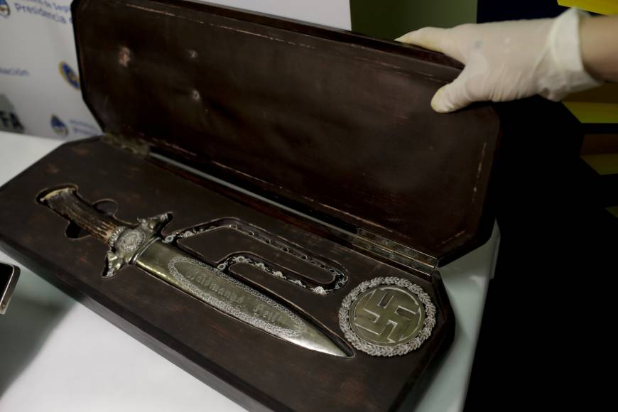 A knife with Nazi markings is seen at the Interpol headquarters in Buenos Aires Friday. In a hidden room in a house near Argentina's capital, police discovered on June 8 the biggest collection of Nazi artifacts in the country's history. | AP
