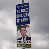 Sinn Fein election posters featuring John Finucane stand in Belfast, Northern Ireland, on May 19. | REUTERS