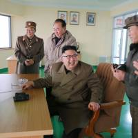 North Korean leader Kim Jong Un reacts after watching the ground jet test of a new rocket engine in this undated picture released on March 19. | KCNA / VIA REUTERS