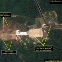 Recent damage to vegetation from a purported North Korean rocket engine test is seen at the Sohae Satellite Launching Station in Tongchang-ri in this satellite photo taken June 22. | AIRBUS DEFENSE AND SPACE / 38 NORTH / VIA KYODO