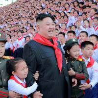 North Korean leader Kim Jong Un poses with participants during the 8th Congress of the Korean Children's Union (KCU) in this undated photo released Thursday.   KCNA / VIA REUTERS