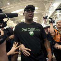 Former NBA basketball player Dennis Rodman arrives at Beijing International Airport Tuesday, ahead of a planned visit to North Korea. | AP
