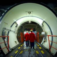 Visitors walk through the reactor of the nuclear power plant that will be dismantled in Muelheim-Kaerlich, Germany, on May 22. | REUTERS