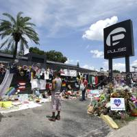Church bells to ring across Orlando as services mark year since 49 were gunned down in gay club