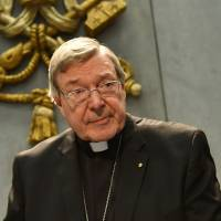Australian police charge top Vatican cardinal with sex offenses
