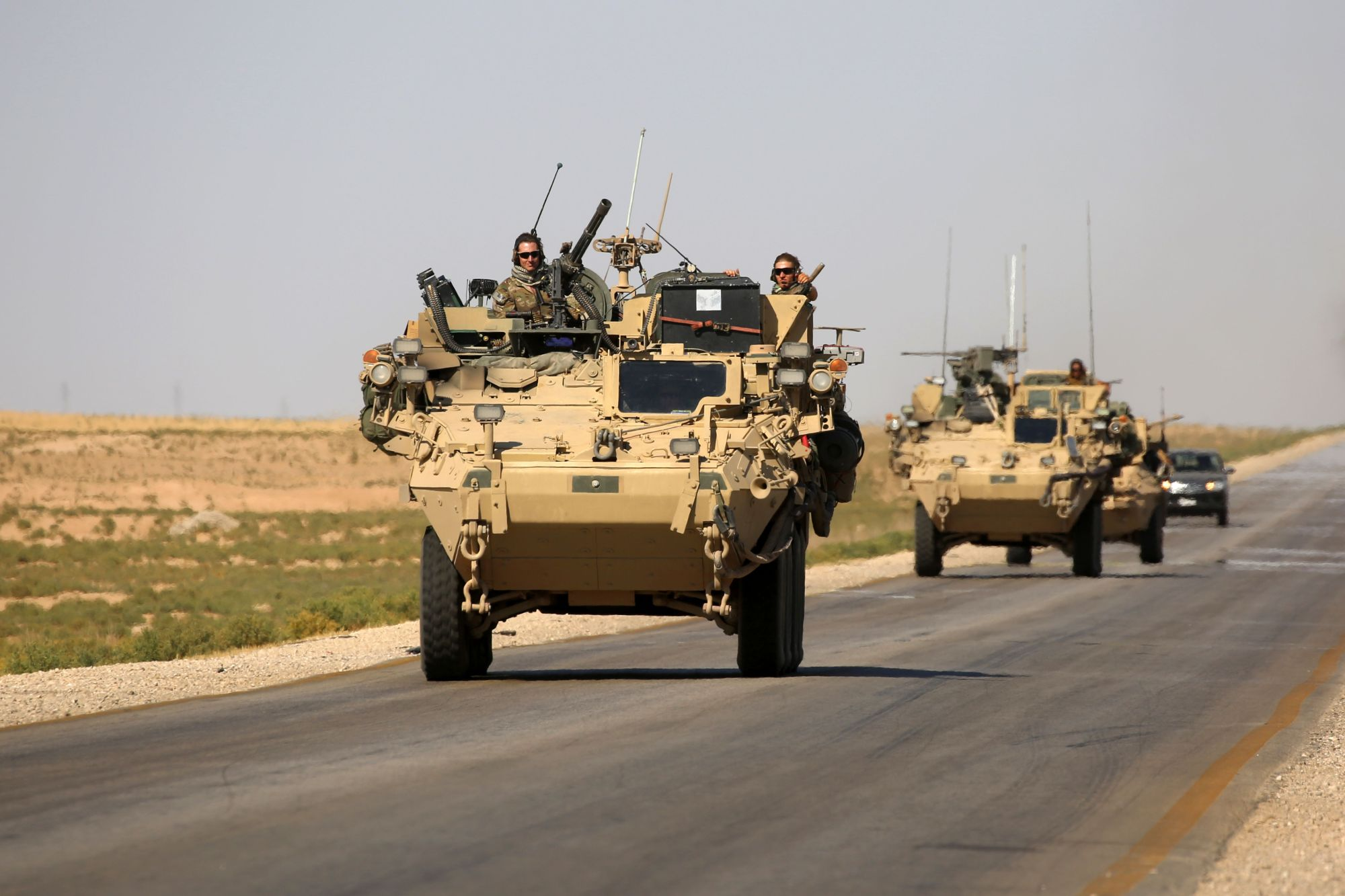 U.S. troops sit atop an armored vehicle on a road near the northern Syrian village of Ain Issa on Saturday. U.S.-backed forces Sunday took a key dam in their drive toward Raqqa.    AFP-JIJI