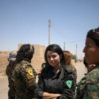 U.S.-backed Kurd, Arab fighters move cautiously into Raqqa as Islamic State ranks fall back to fortifications