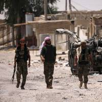 U.S.-backed fighters seize more of Raqqa as Islamic State fortifies last positions