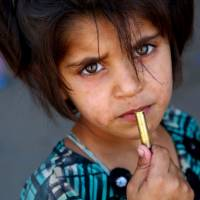 Free to roam, kids finding ways to help families survive, flee Islamic State fighters in Raqqa