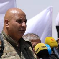 Syrian Democratic Forces (SDF) spokesman Talal Silo speaks during a press conference in Hukoumiya village in Raqqa, Syria, Tuesday. | REUTERS