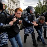 Mass arrests reported as thousands across Russia protest corruption, confront Kremlin