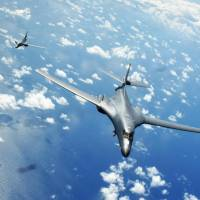Two U.S. Air Force B-1B Lancers fly a 10-hour mission from Andersen Air Force Base in Guam through the South China Sea on Thursday. | U.S. AIR FORCE