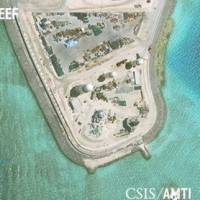 Construction is shown on Mischief Reef, in the Spratly Islands, the disputed South China Sea, in this June 19 satellite image released by CSIS Asia Maritime Transparency Initiative at the Center for Strategic and International Studies (CSIS) to Reuters on Thursday.   CSIS / AMTI DIGITALGLOBE / HANDOUT / VIA REUTERS