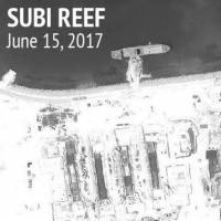 Construction is shown on Subi Reef, in the Spratly Islands, the disputed South China Sea in this June 15 satellite image released by CSIS Asia Maritime Transparency Initiative at the Center for Strategic and International Studies (CSIS) to Reuters on Thursday.   CSIS / AMTI DIGITALGLOBE / HANDOUT / VIA REUTERS