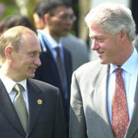 President Bill Clinton (right) shares a light moment with Russian President Vladimir Putin before a Group of Eight meeting in Nago, Okinawa, in 2000. In a series of interviews with American film director Oliver Stone being shown on U.S. television on Monday, Putin said that he inquired about Russia joining NATO when Clinton visited Moscow in 2000. | AP